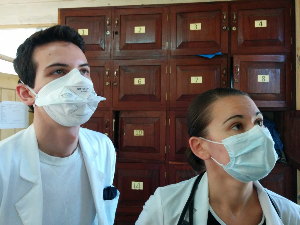 Dane and Lidia wearing N95 masks